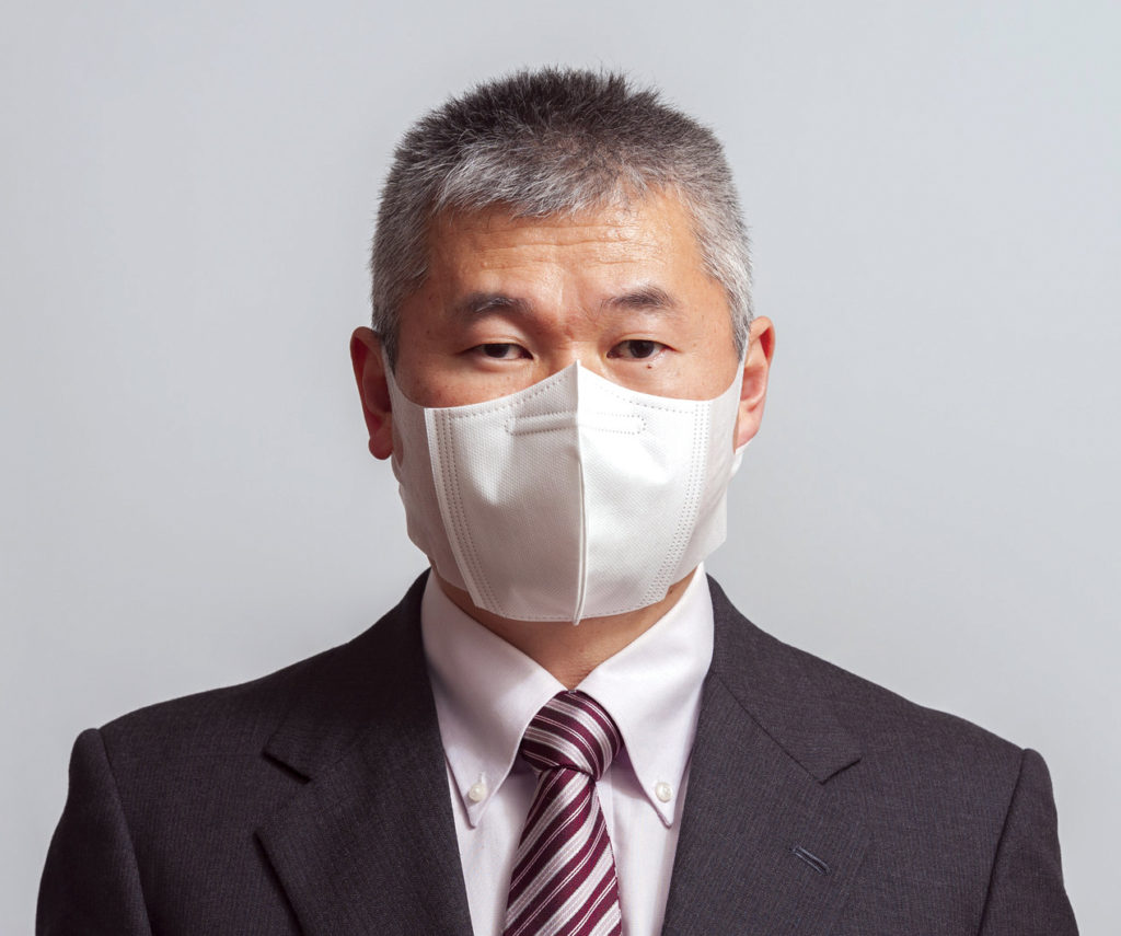 A middle-aged Asian man wearing a face mask.